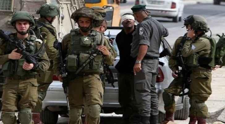 IOF arrests 14 Palestinians in West Bank