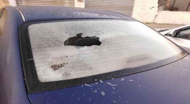 Wind pushes glass panels off building, damages vehicles