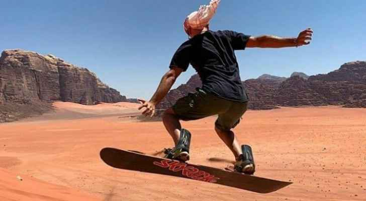 Roya discovers sand surfing in Wadi Rum