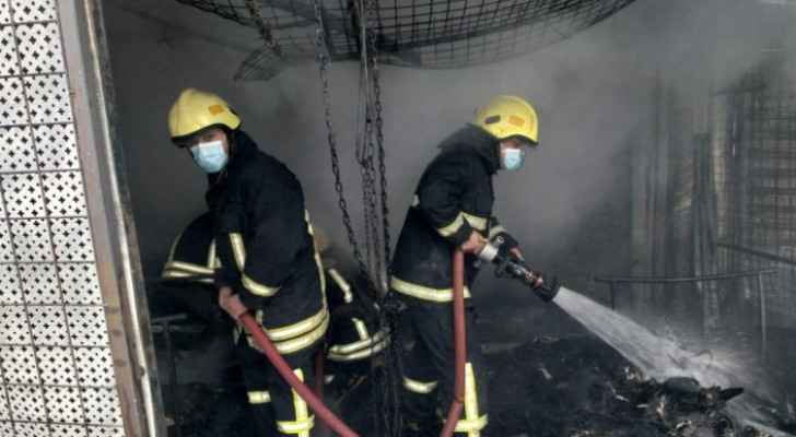 Firefighters extinguish fire in second-hand clothing stores in Zarqa