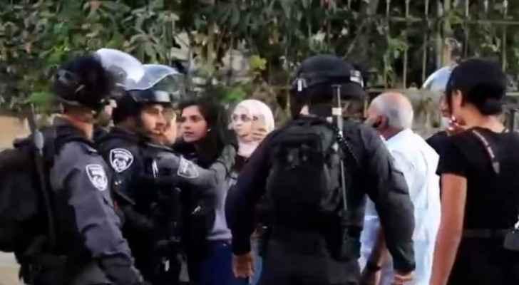 'Raise your head high' says a bystander to journalist Halawani as IOF arrest her in Sheikh Jarrah