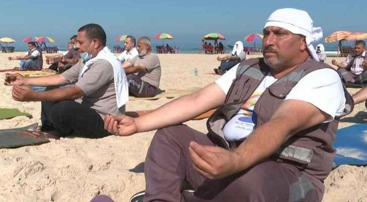 Palestinian paramedics mark International Yoga Day on Gaza beach