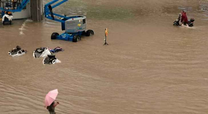 12 killed in flooded subway as torrential rains hit central China