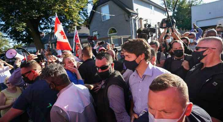 VIDEO: Man charged with assault after throwing stones at Canada's PM