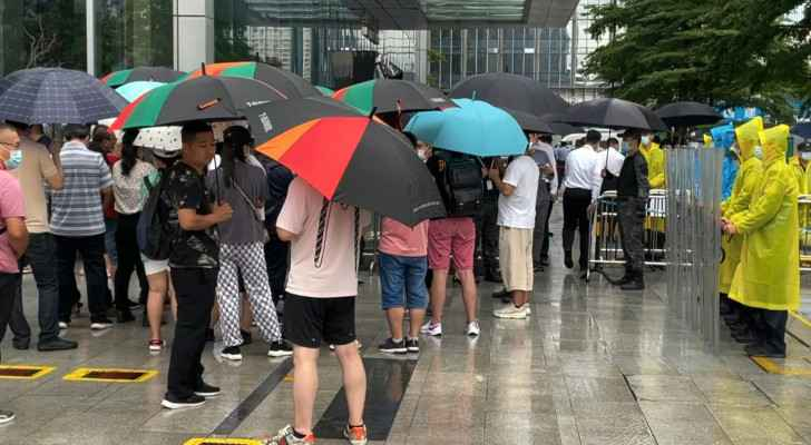 Protests as Chinese property giant Evergrande faces 'tremendous pressure'