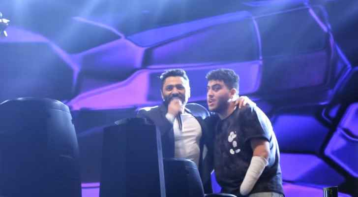 IMAGES: Tamer Hosny invites Saleh onto stage, crowd stands in respect
